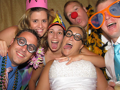 bride in photo booth with friends